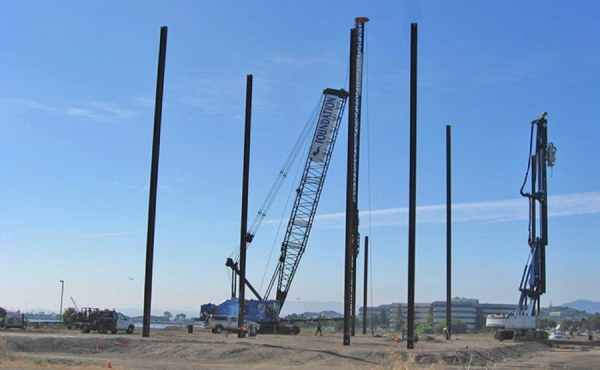 Geosyntec oversaw a pile testing program with 230-foot long piles in order to optimize pile capacity for foundation design.